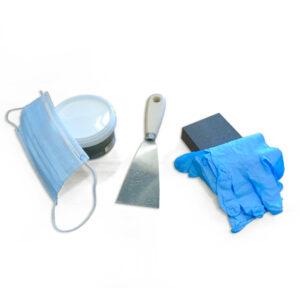 Herramientas y masilla para reparar paredes